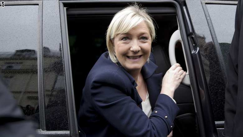 France's far-right Front National (FN) party president Marine Le Pen (C) arrives for the  party's annual rally in honour of Jeanne d'Arc (Joan of Arc) on May 1, 2015 in Paris. AFP PHOTO / KENZO TRIBOUILLARD        (Photo credit should read KENZO TRIBOUILLARD/AFP/Getty Images)