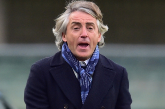 Inter Milan's coach from Italy Roberto Mancini reacts during the Italian Serie A football match Verona vs Inter Milan at the Bentegodi Stadium in Verona on Febrauary 7, 2016.  / AFP / GIUSEPPE CACACE        (Photo credit should read GIUSEPPE CACACE/AFP/Getty Images)