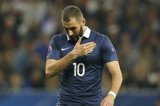 France's forward Karim Benzema reacts during the friendly football match between France and Armenia on October 8, 2015 at the Allianz Riviera stadium in Nice, southeastern France. AFP PHOTO / VALERY HACHE        (Photo credit should read VALERY HACHE/AFP/Getty Images)
