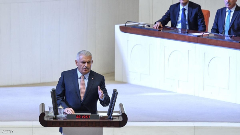 ANKARA, TURKEY - JULY 16: Turkey's PM Binali Yildirim addresses at the Turkish parliament convenes for extraordinary session following the failed coup attempt on July 16, 2016 in Ankara, Turkey. Police regained control overnight after an attempted military coup against President Recep Tayyip Erdogan who has urged his supporters to take to the streets in support to prevent any further flare ups.  (Photo by Erhan Ortac/Getty Images)