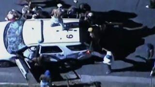 -يحطمون-سيارة-للشرطة-بعد-مقتل-رجل-أسود-على-يد-شرطي-أمريكي-