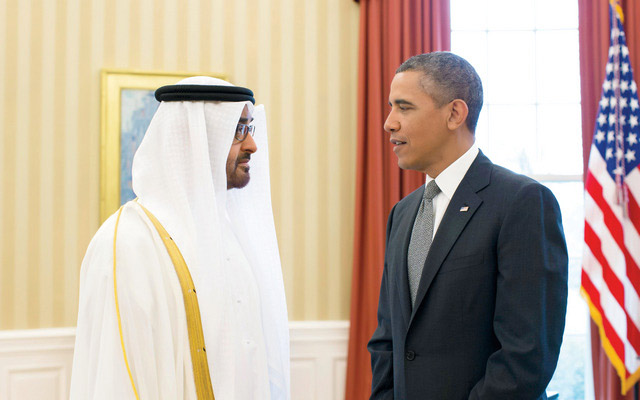 WASHINGTON, DC, UNITED STATES OF AMERICA - April 16, 2013: HH General Sheikh Mohamed bin Zayed Al Nahyan Crown Prince of Abu Dhabi Deputy Supreme Commander of the UAE Armed Forces (L), speaks with The Honorable Barack Obama President of the United States of America (R), in the Oval office prior to a lunch meeting at the White House. ( Ryan Carter / Crown Prince Court - Abu Dhabi ).---..