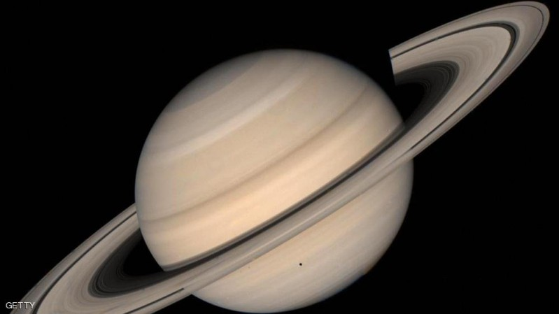 SPACE, SPACE:  This August 1998 NASA file image shows a true color photo of Saturn assembled from Voyager 2 spacecraft.  Three of Saturn's moons L-R: Tethys, 1,050 km. (652 mi.) in diameter; Dione, 1,120 km. (696 mi.); and Rhea, 1,530 km. (951 mi.) are seen in the image. The shadow of Tethys appears on Saturn's southern hemisphere. NASA announced 17 August, 2004 that the Cassini-Huygens space probe discovered two new moons around Saturn, which could be the smallest ever spotted around the ringed planet, NASA officials said Tuesday. The moons, measuring three and four kilometers (about two miles) in diameter, are located 194,000 and 211,000 kilometers (120,500 and 131,000 miles), respectively, from Saturn. They have been temporarily named S/2004 S1 and S/2004 S2.   AFP PHOTO/NASA  (Photo credit should read HO/AFP/Getty Images)