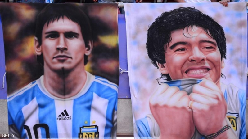 View of posters of Argentinian forward Lionel Messi and Argentinian football star Diego Maradona ahead of the Copa America 2015 football match between Argentina and Paraguay in La Serena, Chile on June 13, 2015. AFP PHOTO /  MARTIN BERNETTI        (Photo credit should read MARTIN BERNETTI/AFP/Getty Images)
