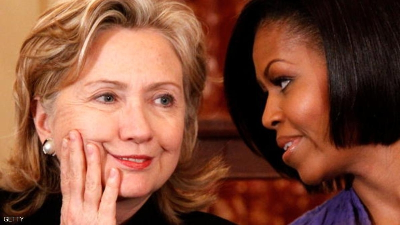 WASHINGTON - MARCH 10:  U.S. Secretary of State Hillary Rodham Clinton (L) and first lady Michelle Obama (R) share a moment during the fourth annual Award for International Women of Courage ceremony at the State Department March 10, 2010 in Washington, DC. The award was to pay tribute to outstanding women leaders worldwide. Ten women were presented with the award this year.  (Photo by Alex Wong/Getty Images)