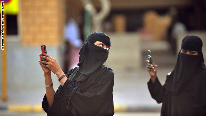 Saudi women take pictures with their mobile phones after the end of a prayer performed on the first day of Eid al-Fitr in the great mosque in the old City of Riyadh, on August 19, 2012 to mark the end of the holy fasting month of Ramadan . Muslims around the world celebrate Eid al-Fitr, marking the end of Ramadan, the Muslim calendar's ninth and holiest month during which followers are required to abstain from food, drink and sex from dawn to dusk.   AFP PHOTO/FAYEZ NURELDINENURELDINE        (Photo credit should read FAYEZ NURELDINE/AFP/GettyImages)