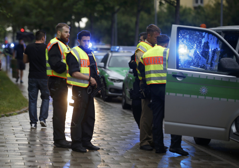 Police secure a street near to the scene of a shooting in Munich, Germany July 22, 2016. REUTERS/Michael Dalder