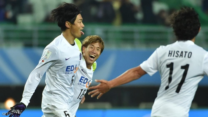 Japan's Sanfrecce Hiroshima defender Kazuhiko Chiba (L-#5) celebrates after scoring a goal with teammates during their Club World Cup quarter-final football match against Congolese side Mazembe in Osaka on December 13, 2015.     AFP PHOTO / KAZUHIRO NOGI / AFP / KAZUHIRO NOGI        (Photo credit should read KAZUHIRO NOGI/AFP/Getty Images)