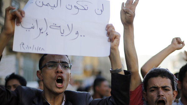 "Protesters demonstrate against the Houthi movement in Sanaa January 28, 2015. The Houthis have emerged as the dominant faction in Yemen after seizing Sanaa in September. The sign reads: ""Yemen will not become an Iranian province.""    REUTERS/Khaled Abdullah (YEMEN - Tags: POLITICS CIVIL UNREST)"