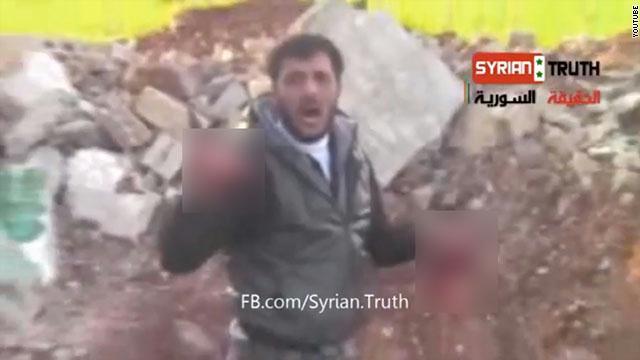 """""""آكل قلب"""" الجندي بسوريا """"أبو صقر"""": السبب فيديو رأيته بهاتفه ! - المواطن"""