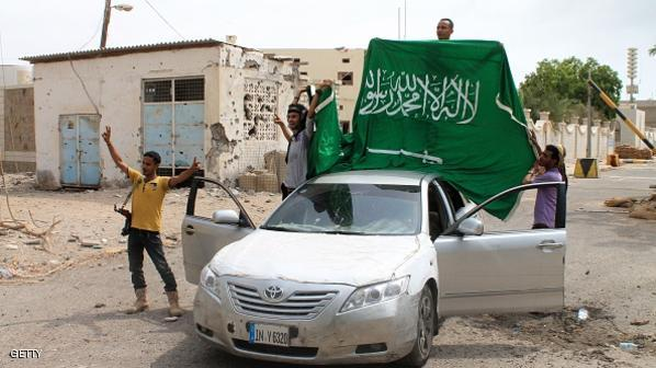 Yemeni fighters loyal to exiled President Abedrabbo Mansour Hadi deploy a Saudi national flag next to the Saudi consulate after they retook it from Shiite Huthi rebels on July 16, 2015 in the southern Yemeni city of Aden. Loyalist forces pressed an offensive to oust Iran-backed rebels from their remaining positions in Aden as exiled ministers prepare to return to assess the damage from four months of fighting.   AFP PHOTO / SALEH AL-OBEIDI        (Photo credit should read SALEH AL-OBEIDI/AFP/Getty Images)