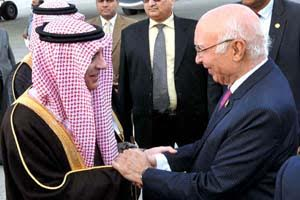 APP50-07 RAWALPINDI: January 07 - Adviser to Prime Minister on Foreign Affairs, Sartaj Aziz receiving Saudi Foreign Minister Adil bin Ahmed Al-Jubeir at Noor Khan Airbase. APP photo by Irshad Sheikh