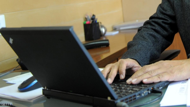 Managing Director of India's Duravit Ashutosh Shah works on a laptop in his office in Ahmedabad on October 17, 2012. AFP PHOTO/Sam PANTHAKY        (Photo credit should read SAM PANTHAKY/AFP/Getty Images)