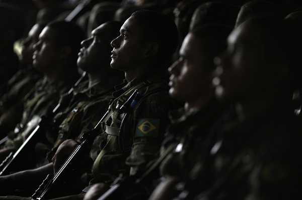 "Brazilian Army soldiers listen to instructions during the operation named ""Agata"" near the town of Oiapoque"