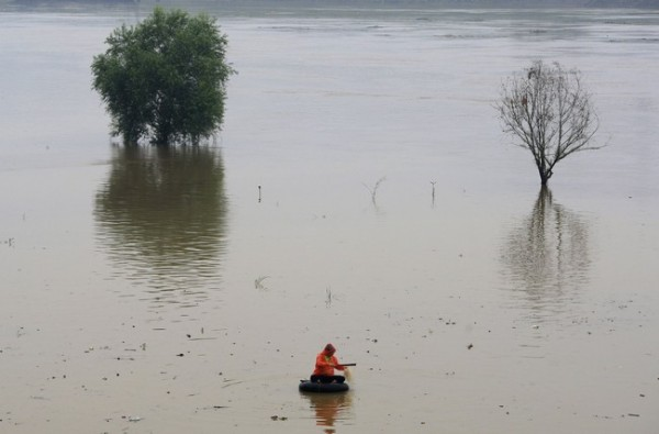 A man fishes on a section of flooded Liuyang River in Changsha