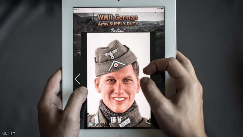 This photo illustration shows a man browsing the website of DiD, a company which produced a Nazi-uniform-clad figurine with a face similar to Bastian Schweinsteiger, in Hong Kong on October 23, 2015.  Bastian Schweinsteiger, the captain of Germany's football team, is taking legal action against the Hong Kong-based company for making Nazi figurines that bear a clear resemblance to him.  AFP PHOTO / Philippe Lopez        (Photo credit should read PHILIPPE LOPEZ/AFP/Getty Images)