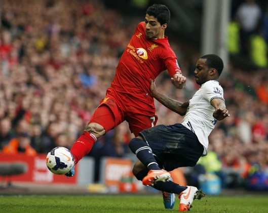 Liverpool's Suarez challenges Tottenham Hotspur's Danny Rose during their English Premier League soccer match at Anfield in Liverpool
