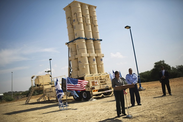 Rice addresses the media as she stands in front of a launcher of an Arrow II ballistic missile interceptor, at Israeli Air Force base, south of Tel Aviv