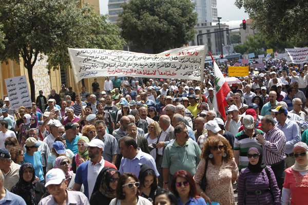 Employees of Lebanon's public sector march through Beirut