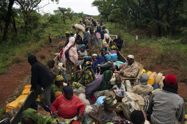 IDPs take a break on an armed AU peacekeeping convoy escorting about one thousand Muslims from the capital Bangui