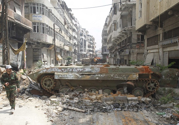The wreckage of an armoured personnel carrier belonging to the forces loyal to Syria's President Bashar al-Assad is seen at al-Hamdeya neighborhood in Homs city