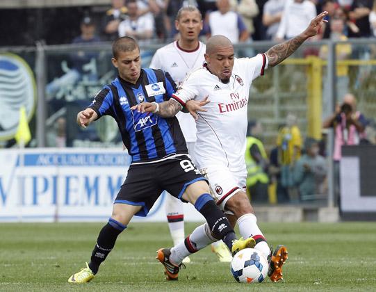 AC Milan's De Jong fights for the ball with Atalanta's De Luca during their Italian Serie A soccer match in Bergamo