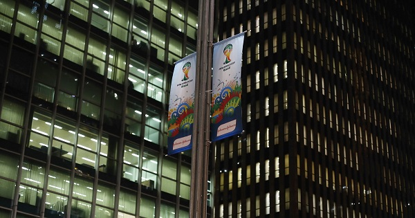 Banners hang from a lamp post in front of buildings in preparation for the 2014 World Cup at the financial centre of Sao Paulo's Avenida Paulista