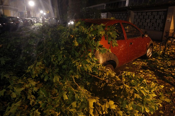 A car is seen damaged after heavy rainfall and a thunderstorm in Dortmund