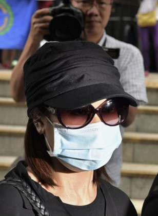 Former beautician Law Wan-tung, 44, leaves a district court in Hong Kong