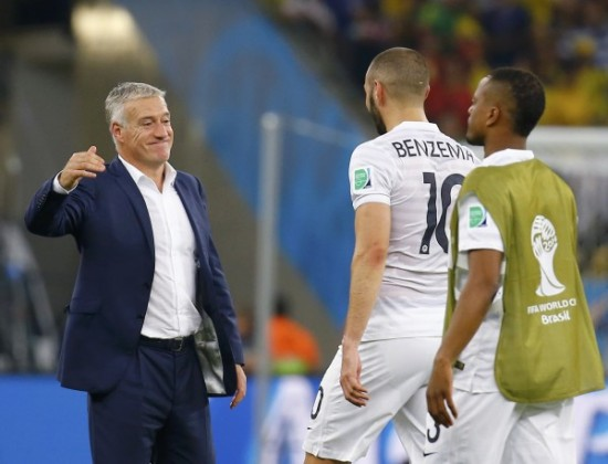 France's coach Deschamps smiles at player Benzema after their 2014 World Cup Group E soccer match against Ecuador ended with a draw at the Maracana stadium in Rio de Janeiro