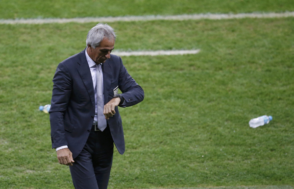 Algeria's coach Halilhodzic checks his watch during extra time in their 2014 World Cup round of 16 game against Germany in Porto Alegre
