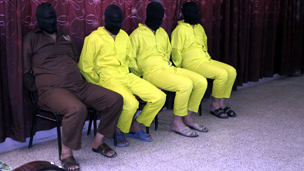 Detainees suspected of being part of an armed cell with links to al Qaeda are shown to the media during a news conference in Baghdad
