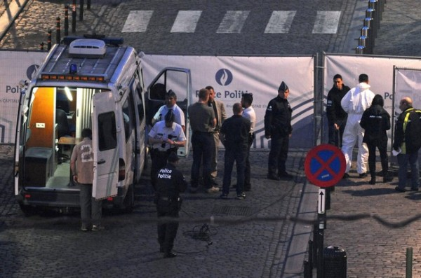 Police personnel are seen at the site of a shooting in Brussels