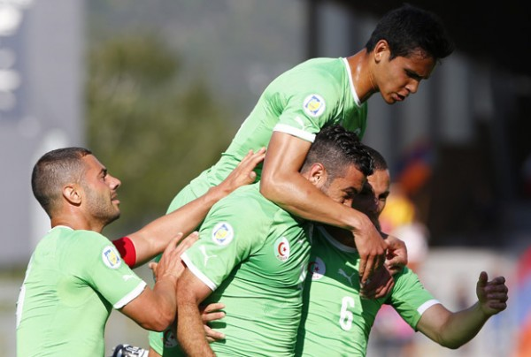 Algeria's Belkalem celebrates scoring a goal with teammates during their international friendly soccer match against Armenia in Sion