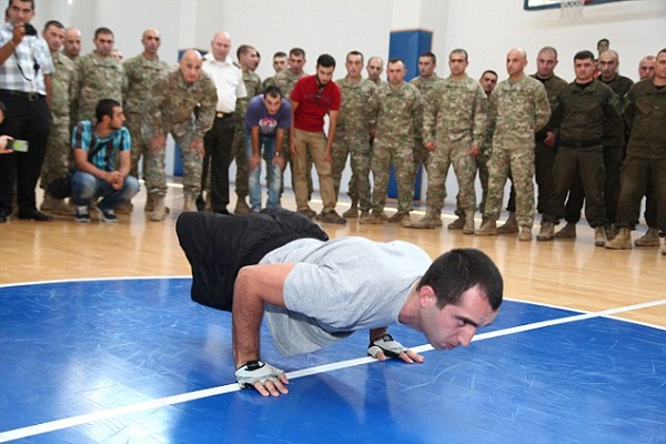 Double amputee Georgian soldier sets new Guinness World Record