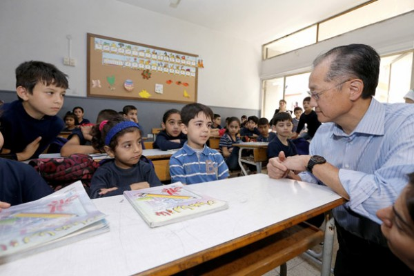 World Bank President Jim Yong Kim interacts with Syrian children refugees inside a school in Burj Hammoud, north of Beirut