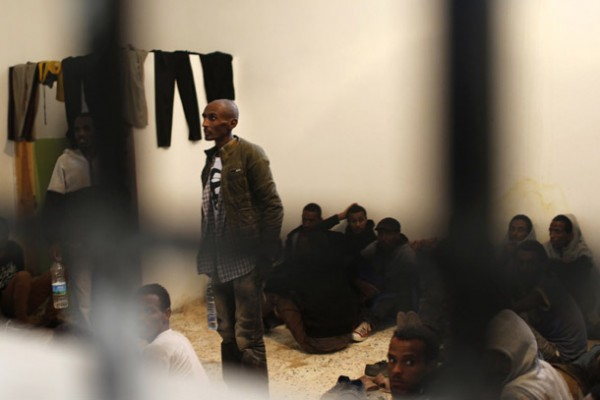 African migrants are seen behind bars at a detention centre in Zawiya, northern Libya