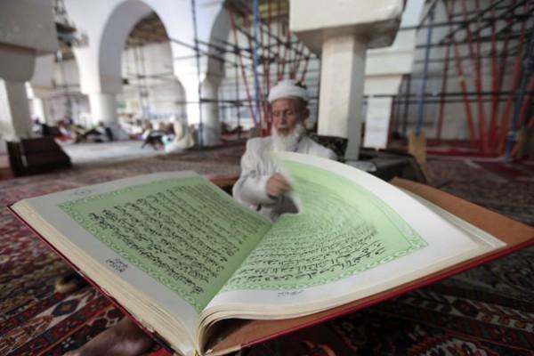 A man reads the Koran in a mosque in Sanaa ahead of Ramadan