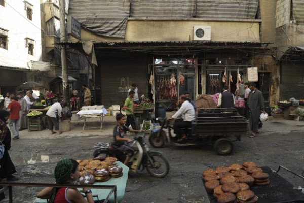 People are pictured in a market during the holy fasting month of Ramadan in Al-Fardous neighbourhood of Aleppo