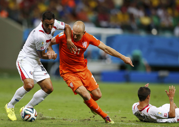 Costa Rica's Michael Umana fights for the ball against Arjen Robben of the Netherlands during their 2014 World Cup quarter-finals at the Fonte Nova arena in Salvador