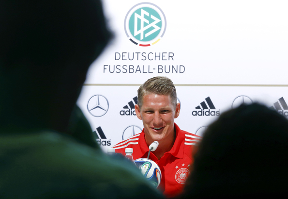 Germany's national soccer player Schweinsteiger addresses a news conference in the village of Santo Andre