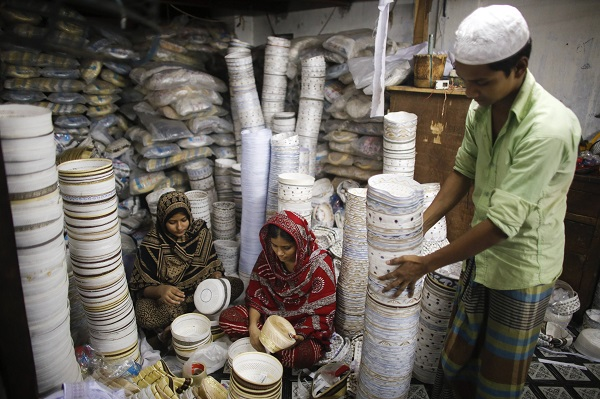 Workers sew prayer caps, which are high in demand during the holy fasting month of Ramadan, at a factory in old Dhaka
