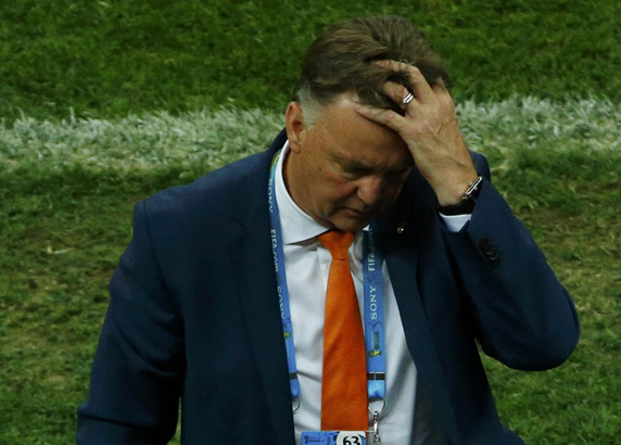 Netherlands coach van Gaal reacts after Blind was removed from the field injured during the 2014 World Cup third-place playoff between Brazil and Netherlands in Brasilia