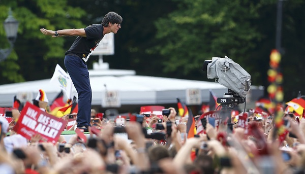 Germany's coach Loew arrives on stage during celebrations to mark team's 2014 Brazil World Cup victory at a 'fan mile' public viewing zone in Berlin