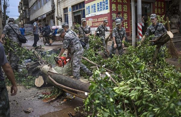 Soldiers clear a street after Typhoon Rammasun hit Zhanjiang