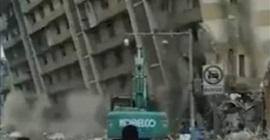 شاهد.. مبنى من 8 طوابق يسقط في اتجاه خاطئ بالصين - المواطن