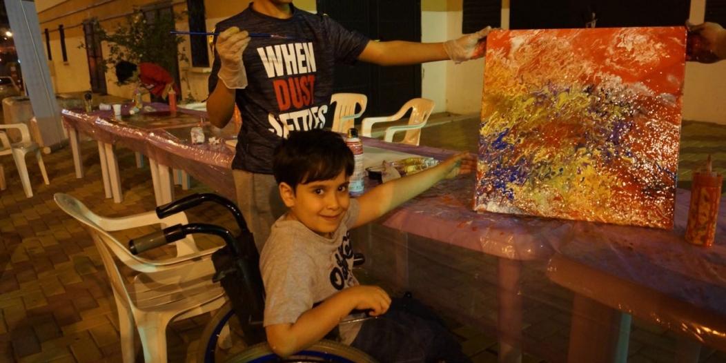 أطفال عسير المعوقون يشاركون في ورشة رسم بالمفتاحة
