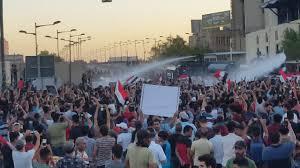اشتباكات بين الأمن ومحتجين في بغداد - المواطن