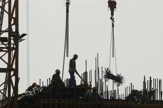 عمال في قطرر