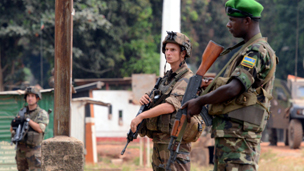 French Sangaris soldiers and Rwandese MI